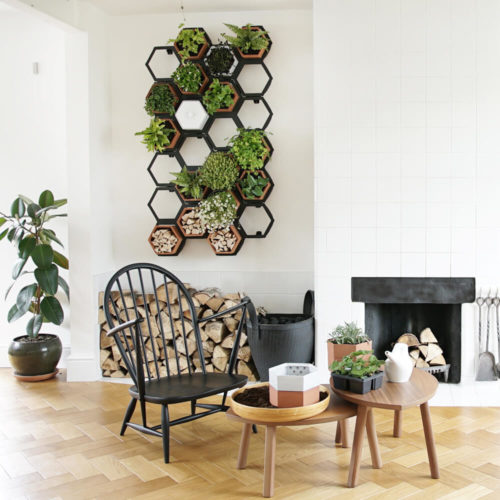 This vertical planter makes a statement in your natural interior, for a welcoming and restorative atmosphere. Achieve a botanical style that's long lasting and easy to care for. An ideal interior living wall kit consisting of just the right number of terracotta planters and frames for your space. There are several kits to choose from, and you can buy separates to grow your garden further. This modular living wall system lets you customise the look, with a choice of kits to suit the space and style of your room (S-XL). There's so much potential to design your perfect layout! Water your vertical horticulture garden from the top of each terracotta planter, through the specially designed holes. The slope to prevents overflowing. The natural terracotta planters and frames are made to be visible, with a beautiful design, texture and quality. The frames are stylishly made from powder coated steel. Reconnect your home interior with nature with a vertical living wall; your mind and body will thank you for it. Bringing nature into our home for wellness called biophilic interiors. Create a vertical living wall statement piece, an urban jungle bathroom, vertical garden kitchen or a relaxing oasis in a bedroom. Add some air purifying and calming plants in your vertical planter, like lavender and peace lilies, creating your dream nature inspired home decor. The terracotta plant pots also make lovely display units in themselves, so why not pop trinkets or kindling in them? These beautiful terracotta planters and frames are made in the UK with passion, expertise and precision.