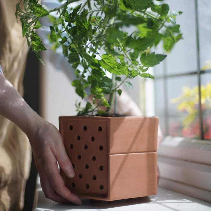 This vertical planter makes a statement in your natural interior, for a welcoming and restorative atmosphere. Achieve a botanical style that's long lasting and easy to care for. An ideal interior living wall kit consisting of just the right number of terracotta planters and frames for your space. There are several kits to choose from, and you can buy separates to grow your garden further. This modular living wall system lets you customise the look, with a choice of kits to suit the space and style of your room (S-XL). There's so much potential to design your perfect layout! Water your vertical horticulture garden from the top of each terracotta planter, through the specially designed holes. The slope to prevents overflowing. The natural terracotta planters and frames are made to be visible, with a beautiful design, texture and quality. The frames are stylishly made from powder coated steel. Reconnect your home interior with nature with a vertical living wall; your mind and body will thank you for it. Bringing nature into our home for wellness called biophilic interiors. Create a vertical living kitchen garden with tomato plants, herbs or other beautiful foliage. These beautiful terracotta planters and frames are made in the UK with passion, expertise and precision.