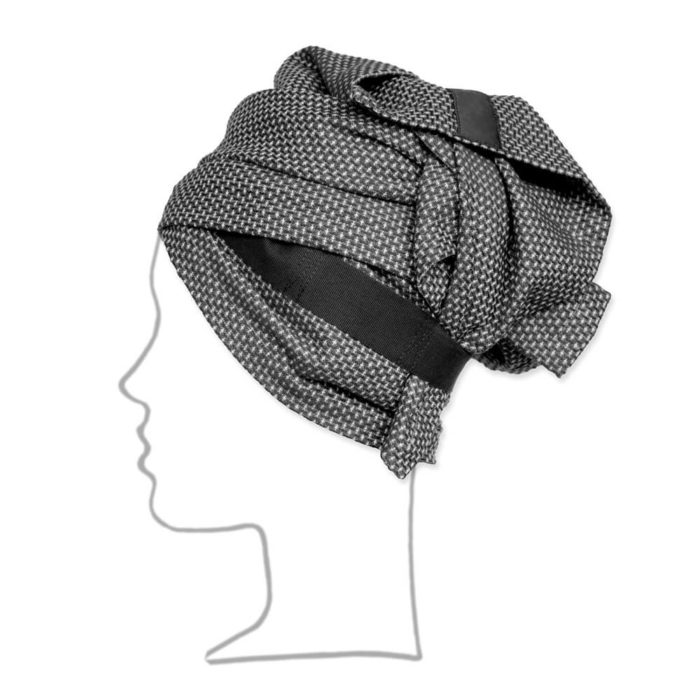 Organic cotton hand and hair towel with a strap for hair wrap functionality, if you'd like to use it a hair turban towel. As well as an ethically made hair towel, it's also a conveniently sized guest towel. Seen here in dark grey. The hand and hair towel wrap is part of the Organic Company wellness series. Material: 100% GOTS certified organic cotton Weave: Piqué Size: 120 X 40 cm