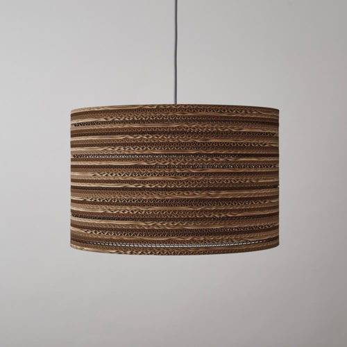 CartOn C1 eco lighting - corrugated cardboard - cylinder pendant, table or floor lamp Eco lighting, handmade in the UK entirely from cardboard. Using cardboard from FSC certified forests and made from 85% recycled material. Maximum wattage: 100w incandescent. Also compatible with CSL and LED lamps of equivalent wattage. The pattern in this cylinder shaped corrugated cardboard lamp shade casts an intricate pattern with a warm glow when lit. Non toxic, biodegradable glue and local materials. See all cardboard light shades at chalkandmoss.com/brand/tabithabargh