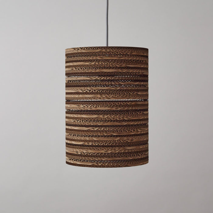 CartOn C2 sustainable lighting - corrugated cardboard, long cylinder pendant, table or floor lamp. Handmade in the UK from 100% cardboard, from FSC certified forests and 85% recycled material. The deep cylinder makes this perfect as a pendant, table or floor fitting. If you're eco aware, this sustainable lighting choice ticks all the boxes. It creates a superb glowing pattern when lit. Non toxic, biodegradable glue and local materials. Max 100w incandescent. Compatible with CSL and LED lamps the same wattage. See all shapes and sizes of cardboard lighting at www.chalkandmoss.com/brand/tabithabargh.