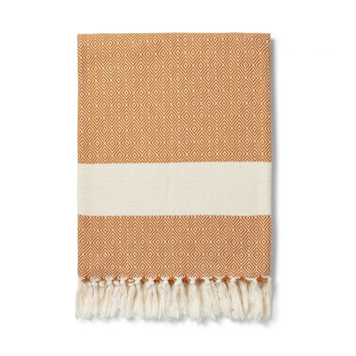 Colourful baby blankets, throws, towels or sarongs in ethical and soft Turkish cotton. Ready to wrap around yourself or a loved one. GOTS certified organic cotton. 170 x 90cm Seen here in tan.