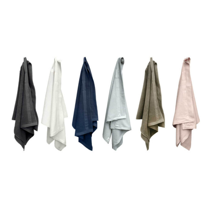 These organic terry weave large bath towels are designed to give you both comfort and functionality with their clever wrap style. Available in several colours, designed to mix and match. Use this large terry cotton wrap around towel as large bathroom towels, as beach towels or beach blankets, or as a gym towel. 160 x 75 cm, 100% ethically made GOTS certified organic cotton Weaving: Terry, grosgrain ribbon