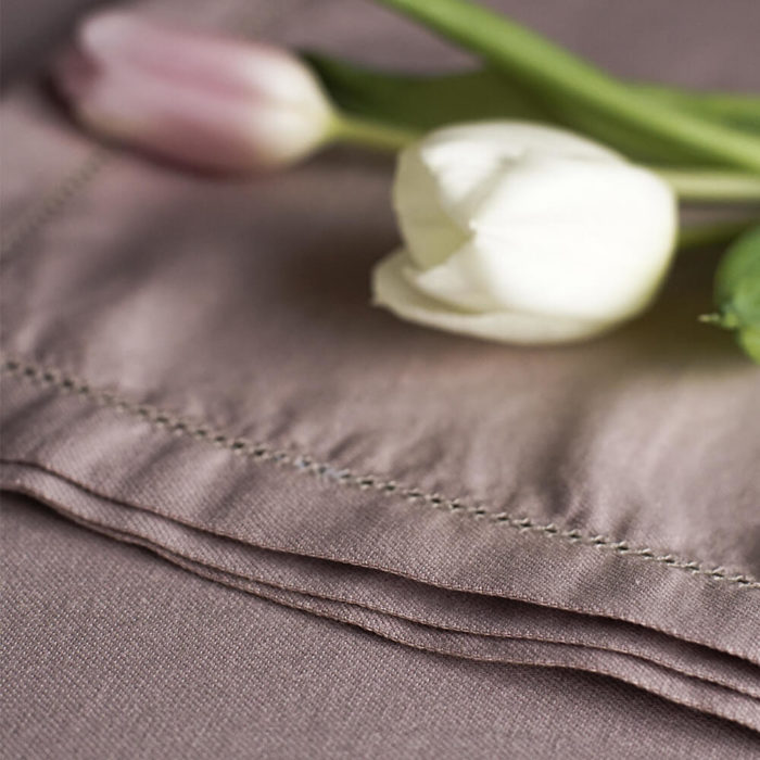 Organic linen napkins These quality flax linen napkins are made from an organic mix of linen and bamboo fibres. Perfect not only for table decoration, but also for zero-waste shopping. Seen here in champagne pink, they're also available in olive grey/green and raw beige. Use them to wrap your groceries, leftovers and packed lunch, or to set-up your elegant dining table. The unique fabric blend helps these sustainable napkins to handle the pressures of life! Beautifully soft and natural, Flax Sack organic table linens are twice as durable as cotton and can last for many years, passing through down generations. Bamboo ensures that the linen doesn't crease excessively and makes the table napkins easy to look after. The Flax Sack's table linen is a sustainable, as it improves with age and becomes softer with each wash. So you won't need to replace your table linen as often. The texture and colour also don't show up stains as easily, so your laundry will reduce, thus reducing your water and energy use. Choose from Champagne Pink, Raw Beige and Olive Grey (which is somewhere between a grey and dark green). These linen napkins are: Soft Crease resistant Twice as durable as cotton Sustainable Hypoallergenic Antibacterial Moisture absorbent Softer with each wash Material: 85% Linen / 15% Bamboo Dimensions: 55cm x 55cm Flax Sack home linen is available in a range of table linen and bed linen in this colour range