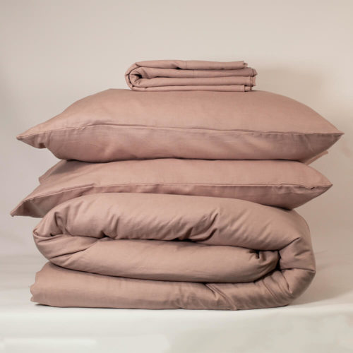 CHAMPAGNE PINK bedding set - organic linen & bamboo 2 pillowcases 1 duvet cover 1 flat sheet (optional, see note) Suitable for a Double bed or King size bed. The unique blend of organic flax linen and bamboo in this champagne pink bedding set makes Flax Sack bedding even softer and easier to look after without compromising on any of the usual linen qualities. Beautifully soft and natural, these bed linens are twice as durable as cotton and can last for decades. Bamboo prevents linen from creasing excessively and makes the fabric extremely easy to look after. The Flax Sack's linen bedding is a sustainable choice that improves with age and becomes softer with each wash. Naturally antibacterial, hypoallergenic and moisture absorbent, Flax Sack sustainable bed linens are also kind to the skin due to the fabric's neutral pH level and its ability to help regulate the body temperature of its users. Both linen and bamboo are advisable for even the most sensitive and eczema prone skin, becoming the perfect solution to ensure a good night's sleep. Every effort has been made to make this bedding affordable compared to much linen bedding on the market, and this set brings the price to you down even more! Features: Soft Crease resistant Twice as durable as cotton Sustainable Hypoallergenic Antibacterial Moisture absorbent Becomes softer with each wash Material: 85% linen / 15% bamboo Care: Do not bleach; wash 30 degrees; iron high Pink duvet set dimensions Double bedding set: Pillow case - 50cm x 75cm Duvet cover - 200cm x 200cm Flat sheet - 230cm x 270cm King bedding set: Pillow case - 50cm x 75cm Duvet cover - 225cm x 225cm Flat sheet - 275cm x 275cm (optional, see note) The linen bedding set is available with or without the flat sheet (separate product listings). Flax Sack bed linen and table linen is available in champagne pink, dark olive and oyster white.