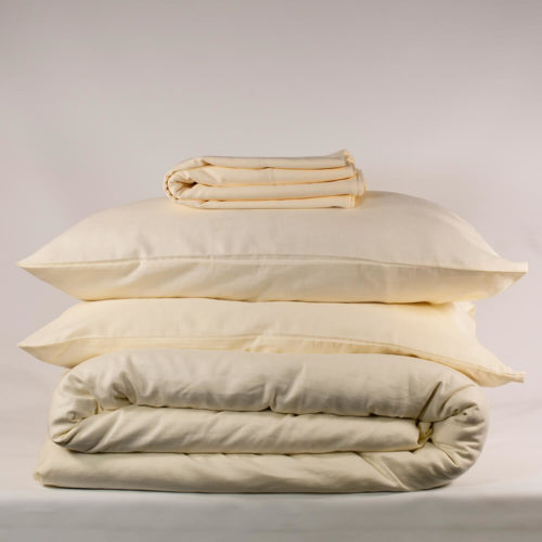 OYSTER WHITE bedding set - organic linen & bamboo 2 Pillowcases 1 Duvet cover 1 Flat sheet (optional, see note) Double or King size duvet cover set The white bedding set comes including or excluding the flat sheet (separate listings). The special blend of organic flax linen and bamboo in this Oyster White bedding set makes Flax Sack bedding soft and easy. Beautifully soft and natural, these bed linens are twice as durable as cotton and can last for decades. Bamboo prevents linen from creasing excessively and makes the fabric extremely easy to look after, and it still has the usual linen qualities. The Flax Sack's linen bedding is a sustainable choice, where the fabric improves with age and becomes softer each time you wash it. Antibacterial, hypoallergenic and moisture absorbent, these natural and plain bed linens are kind to the skin. The fabric in the duvet cover set has a neutral pH level and helps regulate your body temperature. Both linen and bamboo are great for even the most sensitive and eczema suffering skin. It's the perfect solution to ensure a good night's sleep. Cheaper than comparable bedding sets on the market, this affordable linen duvet set brings you a remarkable organic quality. Choose from double or king size white bed set (see dimensions below). Features: Soft Crease resistant Twice as durable as cotton Sustainable Hypoallergenic Antibacterial Moisture absorbent Becomes softer with each wash. Material: 85% linen / 15% bamboo Dimensions Double bedding set: Pillow case - 50cm x 75cm Duvet cover - 200cm x 200cm Flat sheet - 230cm x 270cm King bedding set: Pillow case - 50cm x 75cm Duvet cover - 225cm x 225cm Flat sheet - 275cm x 275cm Care: Do not bleach; wash 30 degrees; iron high.