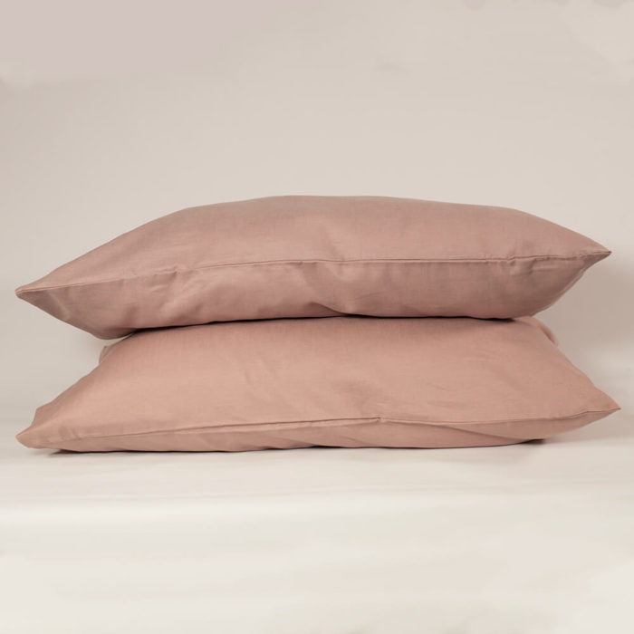 Linen pillowcases in Champagne Pink (set of 2) - organic linen & bamboo - Available colours: Oyster White, Olive Grey or Champagne Pink Also available to buy are the Champagne Pink duvet cover and flat sheet, either separately or as part of a set. This linen pillowcase set is made from organic flax linen and bamboo. This makes Flax Sack pillowcases and the rest of their linen bedding extremely soft and easy to look. It still has the tactile and comfort quality of linen, while also being a more affordable choice. Beautifully soft and natural, these linen pillowcases are twice as durable as cotton and last for decades if looked after. Bamboo stops linen from creasing too much and makes the fabric easy to look after. The Flax Sack's bedding is sustainable, improving with age and getting softer with each wash. It gives a wonderful touch against your skin. Naturally antibacterial, hypoallergenic and moisture absorbent, these linen pillowcases look after your skin, as the fabric is neutral pH level. The unique blend of the material helps regulate the body temperature of its users. Both linen and bamboo are suitable for even the most sensitive and eczema prone skin. Soft Crease resistant Twice as durable as cotton Sustainable Hypoallergenic Antibacterial Moisture absorbent Becomes softer with each wash Material: 85% Linen / 15% Bamboo Dimensions: 50cm x 75cm