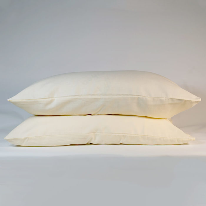 Linen pillowcases in Oyster White (set of 2) - organic linen & bamboo - Available colours: Oyster White, Olive Grey or Champagne Pink Also available to buy are duvet cover and flat sheet, either separately or as part of a set, in all the same colours. This linen pillowcase set is made from organic flax linen and bamboo. This makes Flax Sack pillowcases and the rest of their linen bedding extremely soft and easy to look. It still has the tactile and comfort quality of linen, while also being a more affordable choice. Beautifully soft and natural, these linen pillowcases are twice as durable as cotton and last for decades if looked after. Bamboo stops linen from creasing too much and makes the fabric easy to look after. The Flax Sack's bedding is sustainable, improving with age and getting softer with each wash. It gives a wonderful touch against your skin. Naturally antibacterial, hypoallergenic and moisture absorbent, these linen pillowcases look after your skin, as the fabric is neutral pH level. The unique blend of the material helps regulate the body temperature of its users. Both linen and bamboo are suitable for even the most sensitive and eczema prone skin. Soft Crease resistant Twice as durable as cotton Sustainable Hypoallergenic Antibacterial Moisture absorbent Becomes softer with each wash Material: 85% Linen / 15% Bamboo Dimensions: 50cm x 75cm