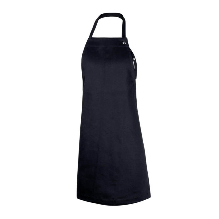 Children's apron, Junior age 7-11 in durable organic cotton. Inviting young chefs to cook, bake and be creative with their families. A simple and practical children's apron design with a neck and waist strap. There is no print on this apron, the design is timeless. Available in dark grey, dark green, dark blue, black, pale rose and sky blue. Seen here in black. 60 x 80 cm For younger chefs, we have the Kids Apron, for 3-6 year olds, also from The Organic Company.