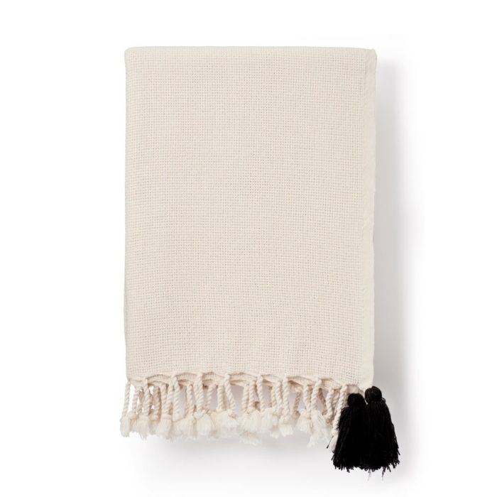 Organic cotton blanket, cream with a delightful black pom pom. Drapes soft and beautifully as a bedspread or sofa throw. 135 x 180cm . .. . . #organiccotton #wellnessblanket#wellness #wellbeing #blanket #blanketsandthrows #cosy #cosyvibes #hygge