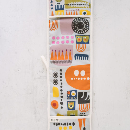 "The ""Shapes"" colourful oven gloves in an abstract, bold and contemporary design. This is the Shapes 1, in a yellow tone, featuring bright and colourful combinations of abstract patterns resembling faces. (Design 2 has a blue dominance). You can mix and match the Shapes colourful oven gloves with tea towels in the same design. You can see the whole Softer + Wild collection here. 85 x 20 cm 100% European cotton with towelling back Heat resistant Hanging loop Wash at 40 degrees Made in Great Britain Softer + Wild dyes are gentle and water based, giving a rustic, organic feel to their products – perfect for presents and giving you comfort, luxe and design to the table and your interior. The fabrics are robust, with a beautiful design that you can keep for many years. The more you use it, the more it softens and relaxes, decorating your home in vibrant colours."