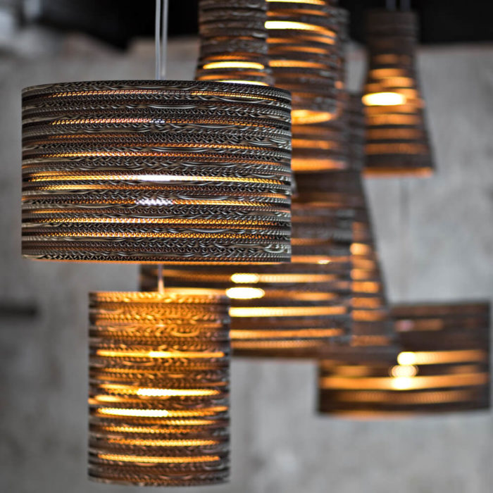 Tabitha Bargh's cardboard light shades. Eco friendly lighting handmade in the UK from FSC certified forests and recycled materials. The material and distinct lines give an atmospheric glow. Available in different shapes and sizes at Chalk & Moss (www.chalkandmoss.com).
