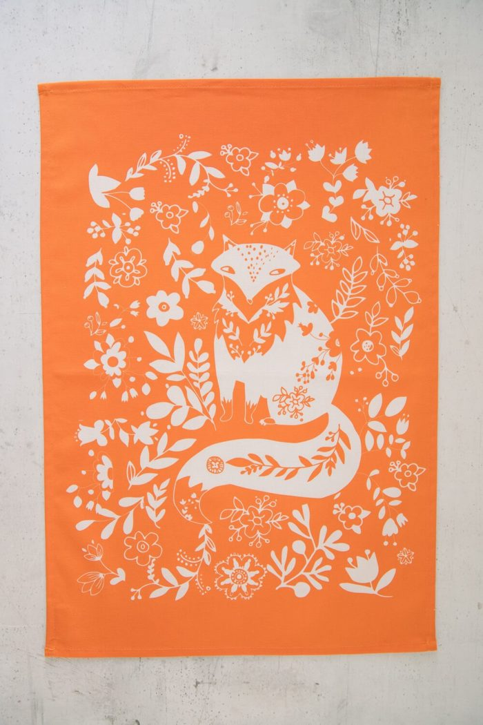 Tangerine fox print funky tea towel in washable cotton. Also available in other colours.