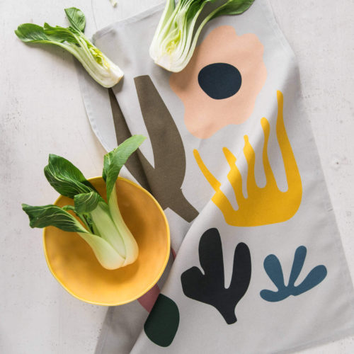 Leaf towel is beautiful, absorbent, soft and colourful. Featuring an abstract custom design inspired by Scandinavian aesthetics and shapes from nature. This little kitchen towel makes a perfect gift for any occasion or to add some sparkle and contemporary feel to your kitchen. The design has a real Matisse flavour. Softer + Wild kitchen tea towels are made from 100% cotton and are hemmed on 4 sides. All fabric patterns are bespoke, original designs created for the specific product by Softer + Wild in their lovely studio in Lewes, UK. They care about the environment, so their products come in a fully recyclable natural card box. Hanging loop 49cm x 70cm 100% cotton Wash at 40 degrees Made in Great Britain