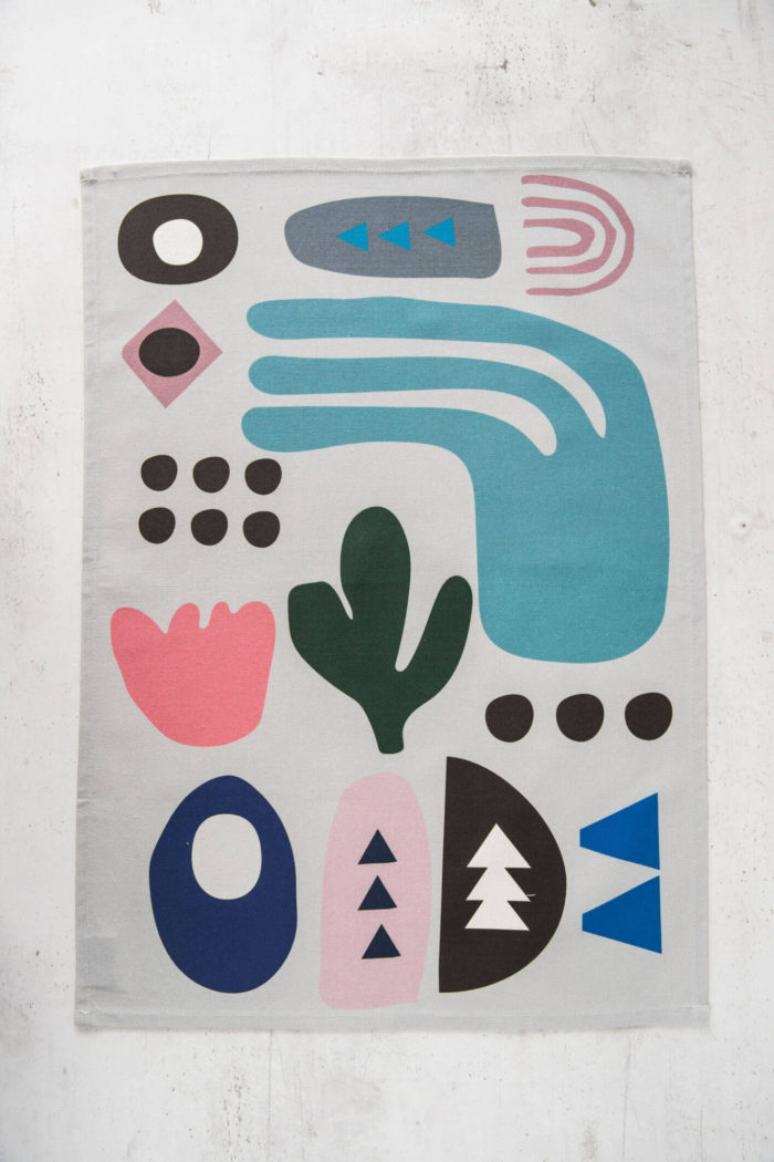 Sea tea towel is wonderfully soft for the hands, and absorbent as a dish towel. Featuring a custom sea inspired design drawing on Scandinavian aesthetics and shapes from nature. Do you know someone quirky and fun loving? Then this kitchen towel will brighten their day! (And kitchen). Softer + Wild kitchen hand towels are made from 100% cotton and hemmed on 4 sides. All fabric patterns are bespoke, original designs made for the specific product, created in Lewes, UK. We care about the environment, so products come in a fully recyclable natural card box. Hanging loop 49cm x 70cm 100% cotton Wash at 40 degrees Made in Great Britain
