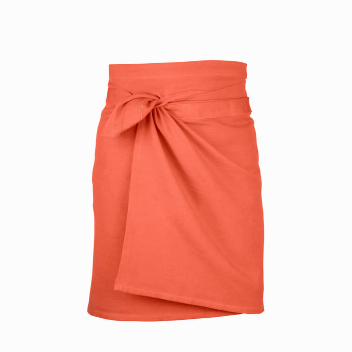 Giant kitchen towel apron in coral. Pantone picked Living Coral as colour of the year 2019. Designed in Denmark, made from GOTS certified organic cotton. A practical and versatile towel that also works well as an apron. Sustainable Scandinavian design in a range of colours. 155 x 60cm