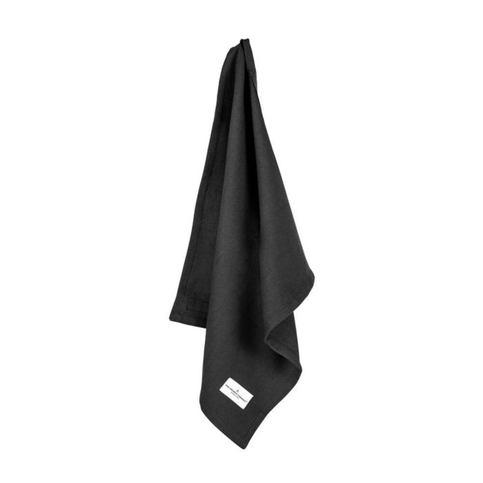 Organic napkins in many colours, shown here in black. Defying seasonal trends, these cotton napkins are designed for long term use. They have a handy loop for hanging or attaching chopsticks or other table decor. Sustainable Scandinavian kitchen textiles and homewares. Designed in Copenhagen, Denmark. 40x50cm