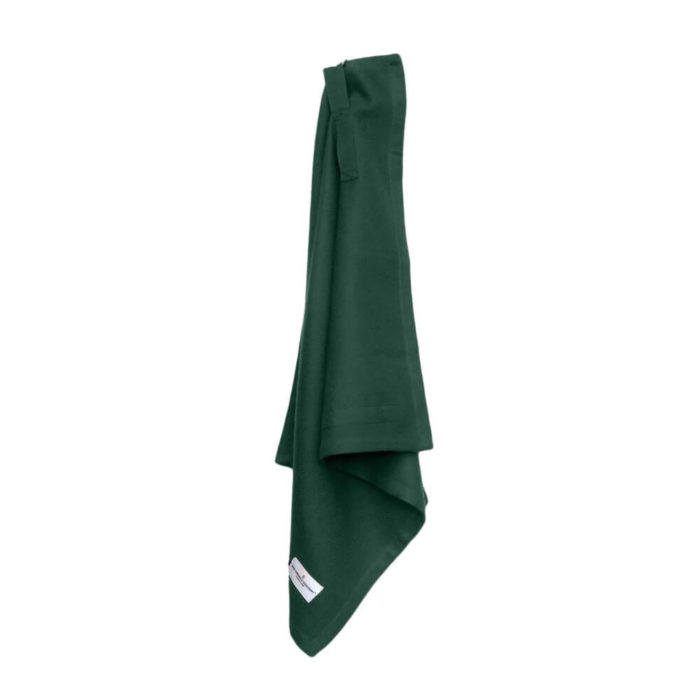 Organic napkins in many colours, shown here in lush forest dark green. Defying seasonal trends, these cotton napkins are designed for long term use. They have a handy loop for hanging or attaching chopsticks or other table decor. Sustainable Scandinavian kitchen textiles and homewares. Designed in Copenhagen, Denmark. 40x50cm