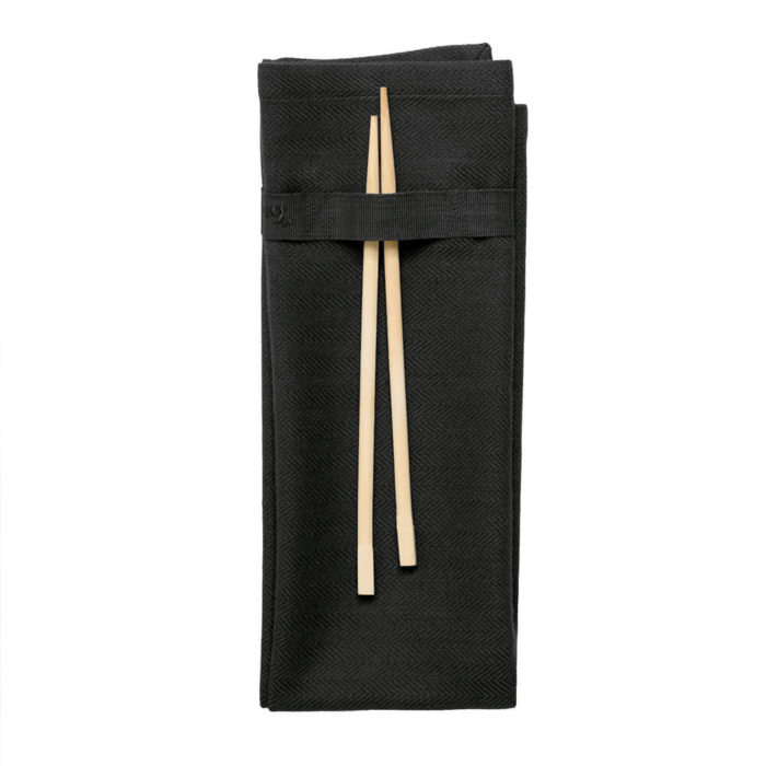 Black napkin in organic cotton. Designed in Denmark, showcasing the best of Scandinavian design. Available in many colours. Handy loop for hanging or attaching decor or chopsticks.
