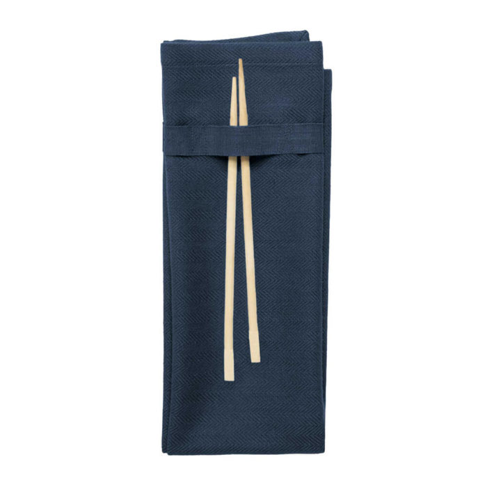 Organic napkins in many colours, shown here in midnight like dark blue. Defying seasonal trends, these cotton napkins are designed for long term use. They have a handy loop for hanging or attaching chopsticks or other table decor. Sustainable Scandinavian kitchen textiles and homewares. Designed in Copenhagen, Denmark. 40x50cm
