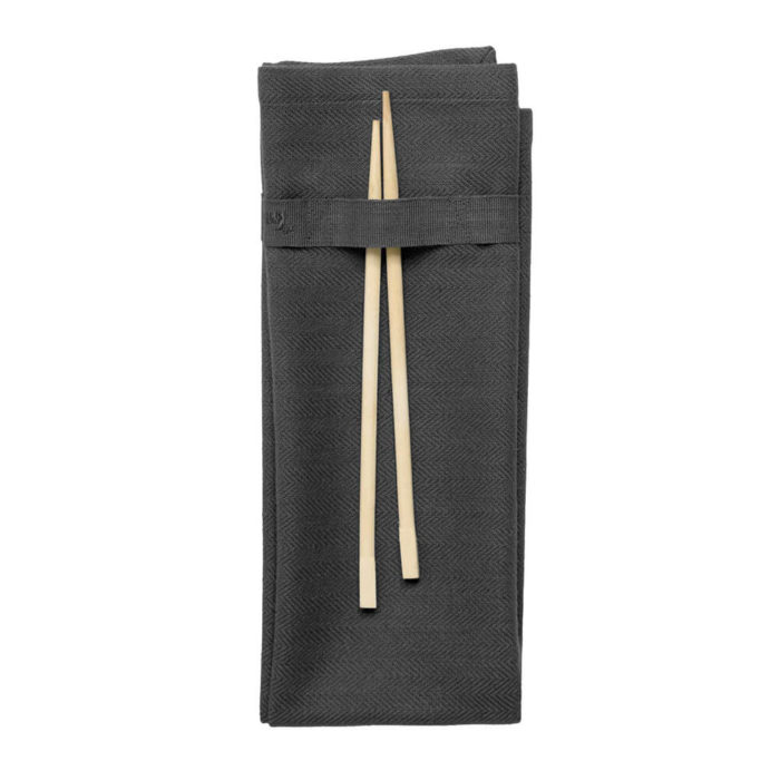 Organic napkins in many colours, shown here in dark grey. Defying seasonal trends, these cotton napkins are designed for long term use. They have a handy loop for hanging or attaching chopsticks or other table decor. Sustainable Scandinavian kitchen textiles and homewares. Designed in Copenhagen, Denmark. 40x50cm