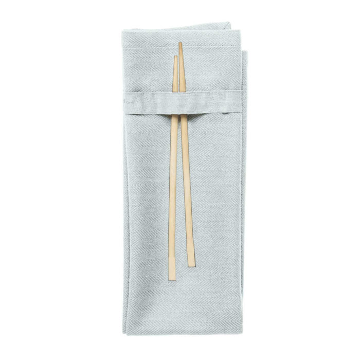 Organic napkins in many colours, shown here in sky blue. Defying seasonal trends, these cotton napkins are designed for long term use. They have a handy loop for hanging or attaching chopsticks or other table decor. Sustainable Scandinavian kitchen textiles and homewares. Designed in Copenhagen, Denmark. 40x50cm