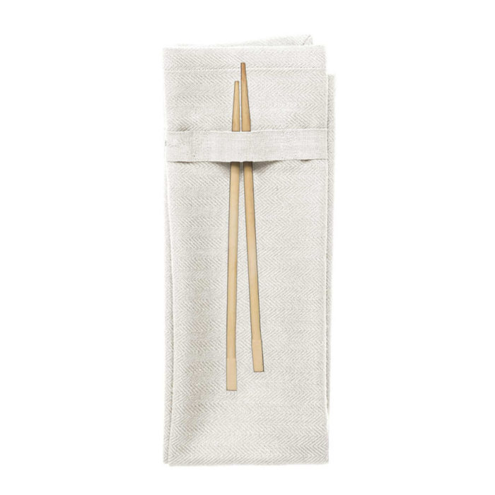 Organic napkins in many colours, shown here in natural white. Defying seasonal trends, these cotton napkins are designed for long term use. They have a handy loop for hanging or attaching chopsticks or other table decor. Sustainable Scandinavian kitchen textiles and homewares. Designed in Copenhagen, Denmark. 40x50cm