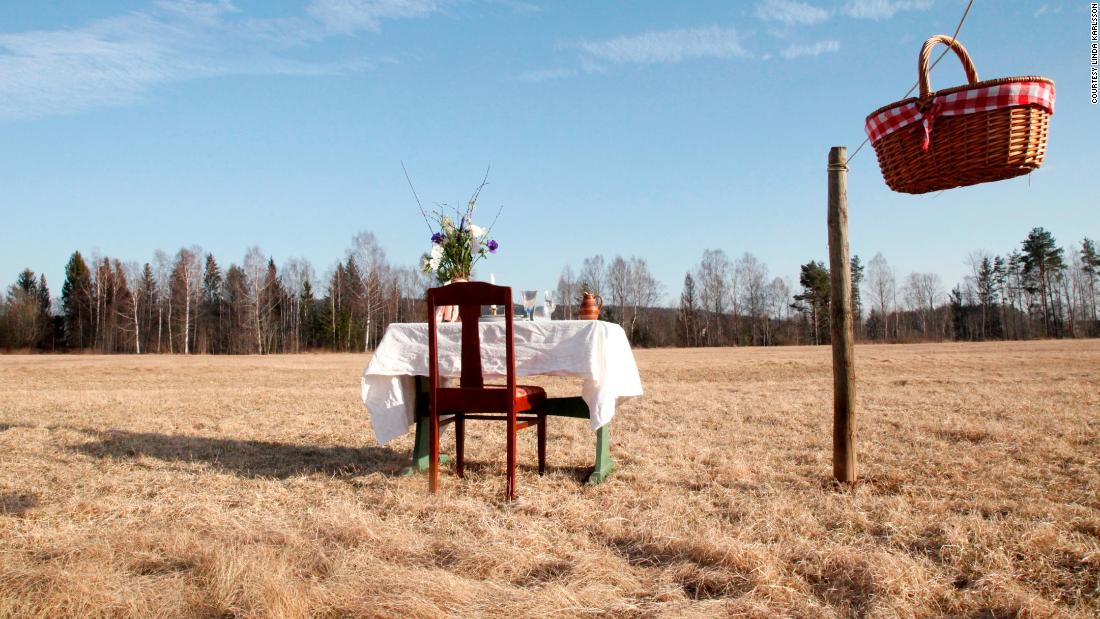 """Table for One"", or ""Bord för En"" is one couple's answer to how to enjoy a restaurant meal during Coronavirus. At Table for One, solo diners sit alone on a small table in a Swedish meadow. They're served, without a waiter, via a basket on a rope from the kitchen."