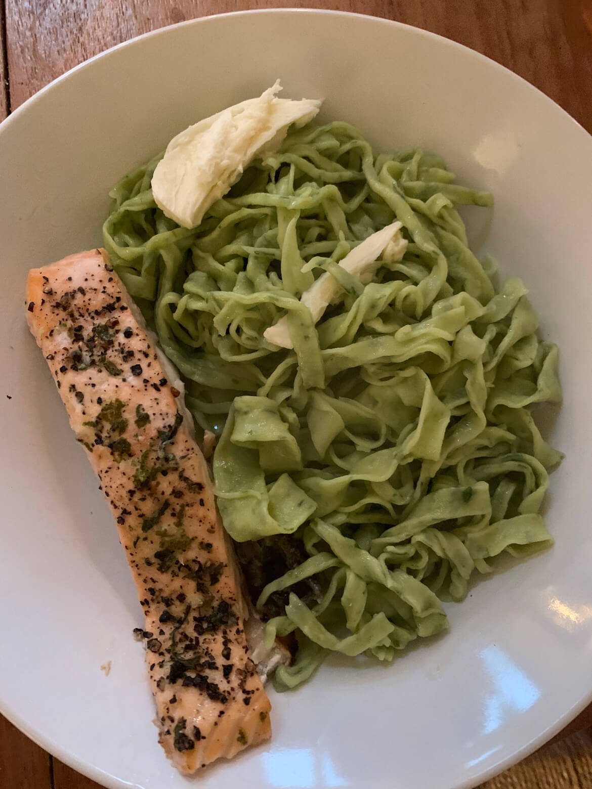 Wild garlic pasta recipe - home made pasta dough, cooked and served with oven baked salmon.