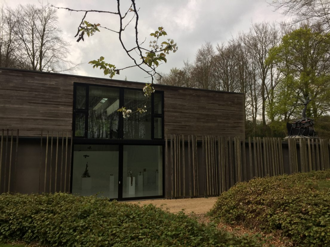 Wood cladded visitor centre with large windows overlooking the woodland and Sculpture park. Cass Sculpture Foundation 2017