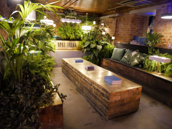 To make the exhibition space at Clerkenwell Design Week more comfortable and inviting, Bert Frank lighting company opted for a biophilic approach with lots of plants and plant motifs.