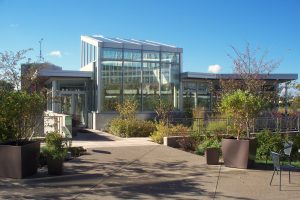 Biophilic design: Center for Sustainable Landscapes, Phipps Conservatory and Botanical Gardens. The floor to ceiling windows allow daylight to stream in, and give people full visibility in and out. Those inside the building are enveloped into the surrounding greenery.