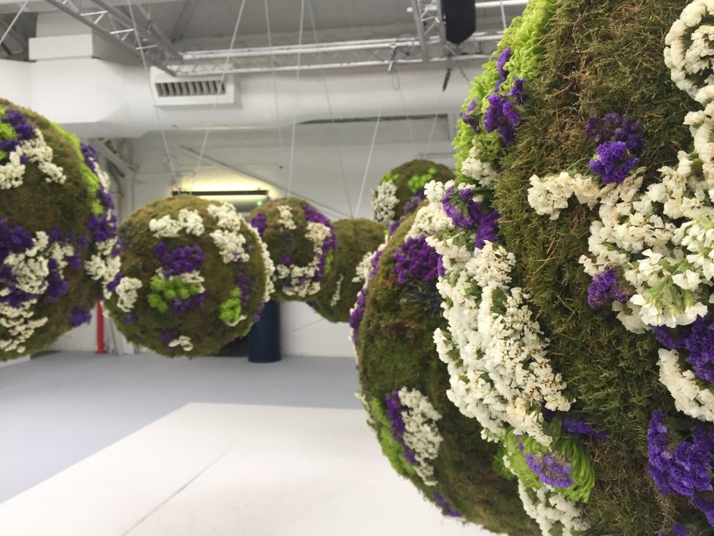 Hanging green flower balls installation for House & Garden fair.