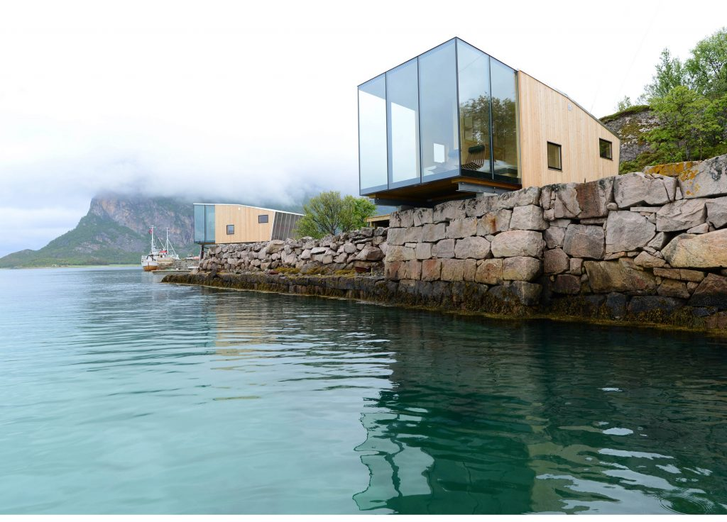 Norwegian cabin overlooking the Steigen archipelago, surrounded by sea and mountains. The resort aims to be self sustainable within 5 years of opening.