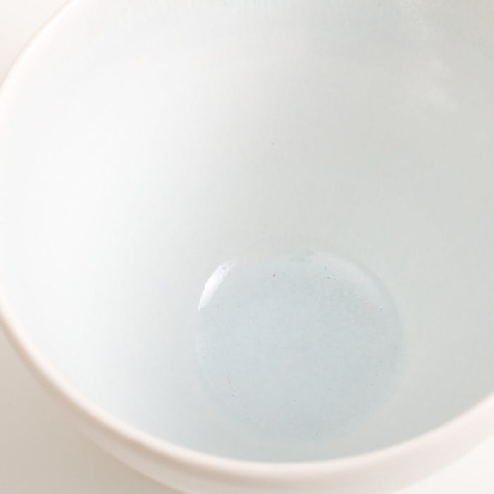 Handmade porcelain coloured deep bowl pale blue, shown in close up. Hand-thrown with natural ridges. Beautiful on its own or as part of a mix and match set. Available in 3 sizes and 4 colours: Pink, blue, turquoise and grey. Please see other listings for sizes and colours.