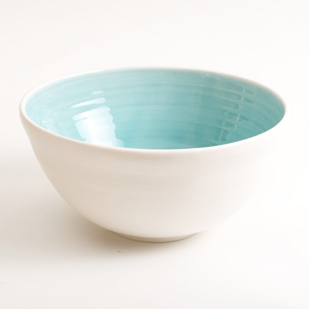 Handmade porcelain bowl turquoise large. Hand-thrown with natural ridges. Beautiful on its own or as part of a mix and match set. Available in 3 sizes and 4 colours: Pink, blue, turquoise and grey. Please see other listings for sizes and colours. By Linda Bloomfield.