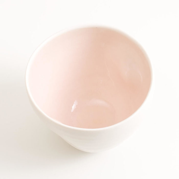 Handmade porcelain coloured deep bowl pink medium. Hand-thrown with natural ridges. Beautiful on its own or as part of a mix and match set. Available in 3 sizes and 4 colours: Pink, blue, turquoise and grey. Please see other listings for sizes and colours.
