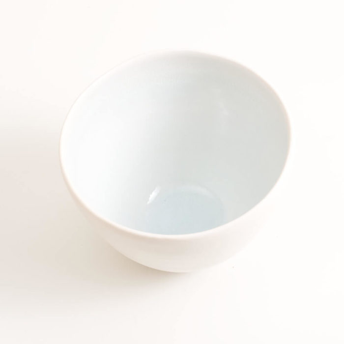 Handmade porcelain coloured deep bowl blue in size small. Handmade porcelain bowl turquoise small. Hand-thrown with natural ridges. Beautiful on its own or as part of a mix and match set. Available in 3 sizes and 4 colours: Pink, blue, turquoise and grey. Please see other listings for sizes and colours.