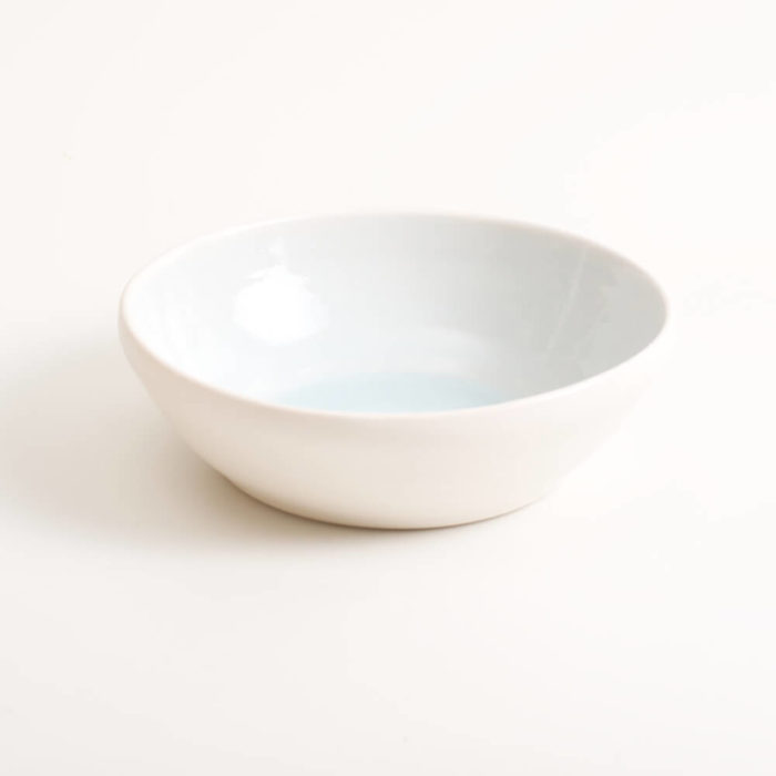 Handmade blue shallow porcelain soup bowl. Hand-thrown with natural ridges and pale pastel colour inside. Perfect for cereal or soup. Beautiful on its own or as part of a mix and match set. Available in 4 colours: Pink, blue, turquoise and grey.