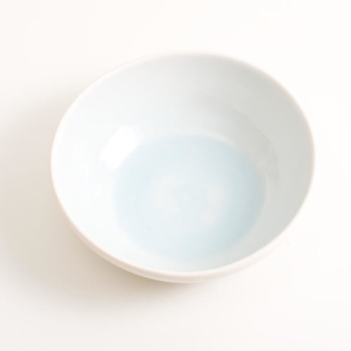 Handmade shallow porcelain bowl in blue. Hand-thrown with natural ridges and pale pastel colour inside. Perfect for cereal or soup. Beautiful on its own or as part of a mix and match set. Available in 4 colours: Pink, blue, turquoise and grey.