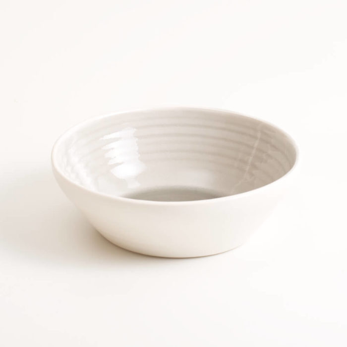 Handmade shallow bowl in porcelain. Hand-thrown with natural ridges and pale coloured pastel inside. Perfect for cereal or soup. Beautiful on its own or as part of a mix and match set. Available in 4 colours: Pink, blue, turquoise and grey.