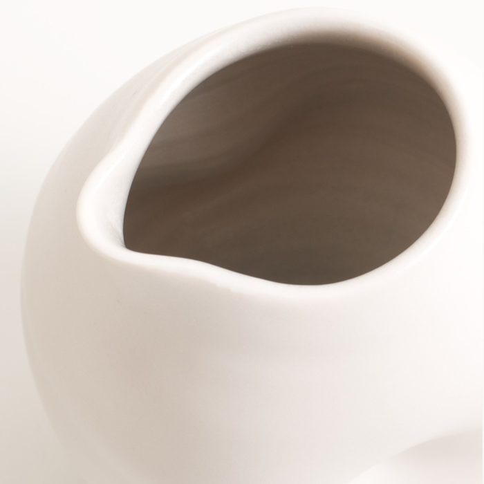 Handmade porcelain dimpled jug grey inside. With a matt white glaze on the outside and soft coloured inside. Available in white, grey and turquoise, in two sizes. Perfectly formed dimples to fit in your hand. Handmade by Linda Bloomfield in London. Sold on chalkandmoss.com.