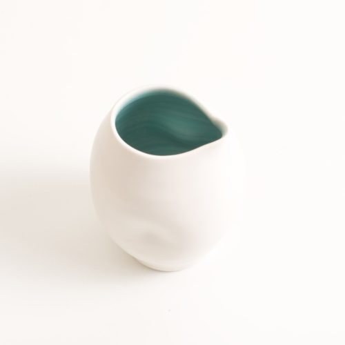 Handmade porcelain dimpled jug turquoise. With a matt white glaze on the outside and soft coloured inside. Available in white, grey and turquoise, in two sizes. Perfectly formed dimples to fit in your hand. Handmade by Linda Bloomfield in London. Sold on chalkandmoss.com.