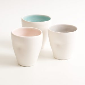 Handmade dimpled mug set. With a matt white glaze on the outside and soft coloured inside. Available in pale blue, pale pink, grey and turquoise. Perfectly formed dimples to fit in your hand, where the shape is inspired by Japanese tea traditions. Handmade by Linda Bloomfield in London. Sold on chalkandmoss.com.