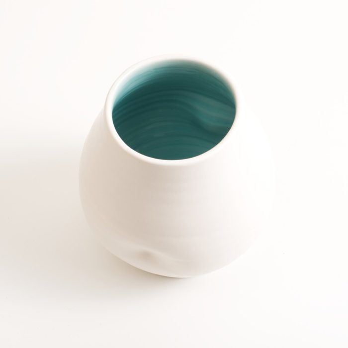 Handmade dimpled porcelain vase turquoise inside, hand thrown by Linda Bloomfield in London. Also available with pale blue inside. A great gift, paired with the Linda Bloomfield dimpled jug and cup.