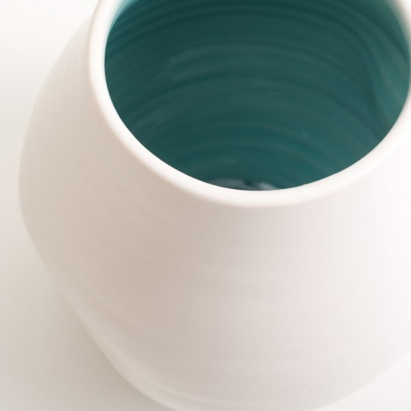 Handmade dimpled porcelain vase turquoise, hand thrown by Linda Bloomfield in London. Also available with pale blue inside. A great gift, paired with the Linda Bloomfield dimpled jug and cup.