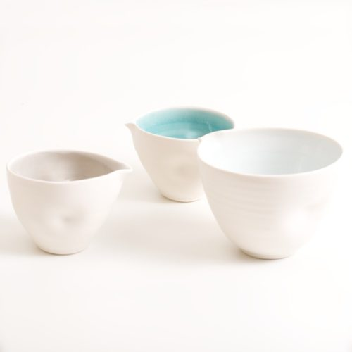 handmade pottery bowl with tactile dimples. Small or medium size. Inside glazed in a choice of: pale blue, turquoise, pink or grey.