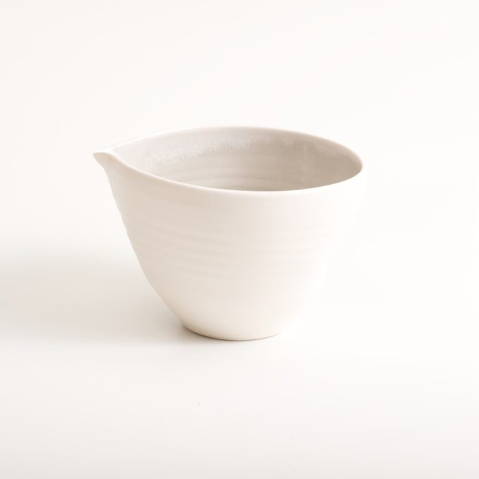 Handmade porcelain pouring bowl medium grey with tactile dimples. Small or medium size. Inside glazed in a choice of: pale blue, turquoise, pink or grey.