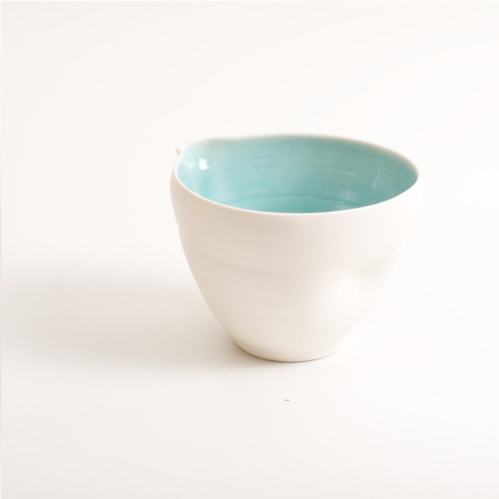 Handmade dimpled porcelain pouring bowl with tactile dimples. Small or medium size. Inside glazed in a choice of: pale blue, turquoise, pink or grey.