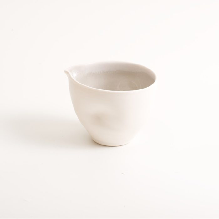Handmade porcelain condiments bowl ideal for sauces, mayonnaise or hummus. Small or medium size with tactile dimples instead of handles. Inside glazed in pale blue, turquoise, pink or grey.